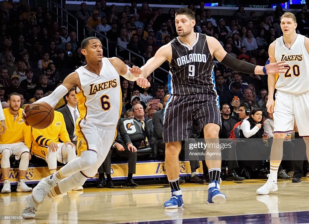 Jordan Clarkson (L) of Los Angeles Lakers in action against Nikola Vucevic (C) of Orlando Magic during a NBA game between Los Angeles Lakers and Orlando Magic at Staples Center in Los Angeles, USA on January 08, 2017.