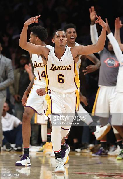 Jordan Clarkson of the Los Angeles Lakers and his teammates on the bench react after Clarkson made a threepoint shot late in the fourth period...