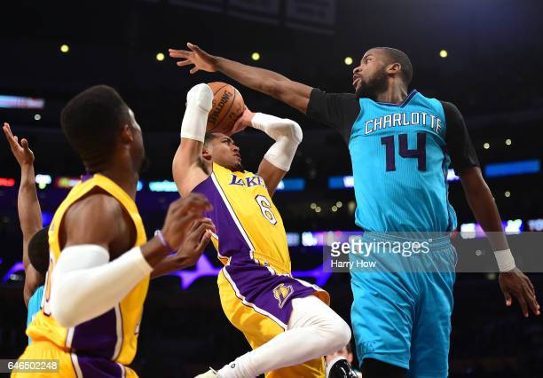 Jordan Clarkson of the Los Angeles Lakers attempts a shot over the hands of Michael KiddGilchrist of the Charlotte Hornets during a 109104 Hornet win...