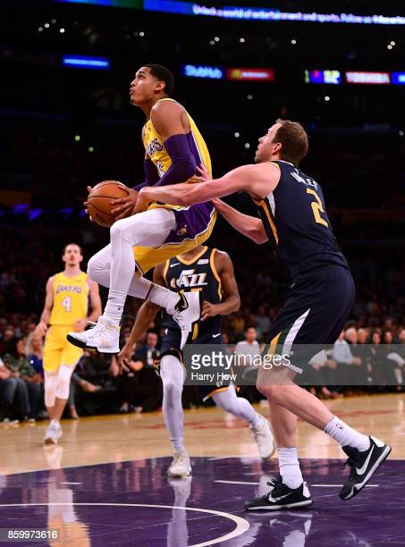 Jordan Clarkson of the Los Angeles Lakers gets fouled by Joe Ingles of the Utah Jazz as he jumps to the basket during the first half at Staples...