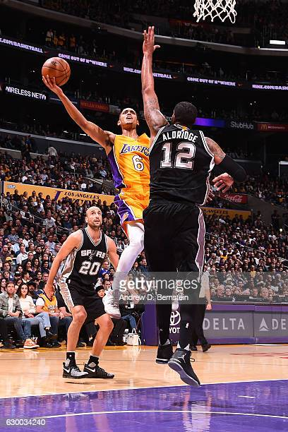 Jordan Clarkson of the Los Angeles Lakers goes up for a lay up against the San Antonio Spurs on November 18 2016 at STAPLES Center in Los Angeles...