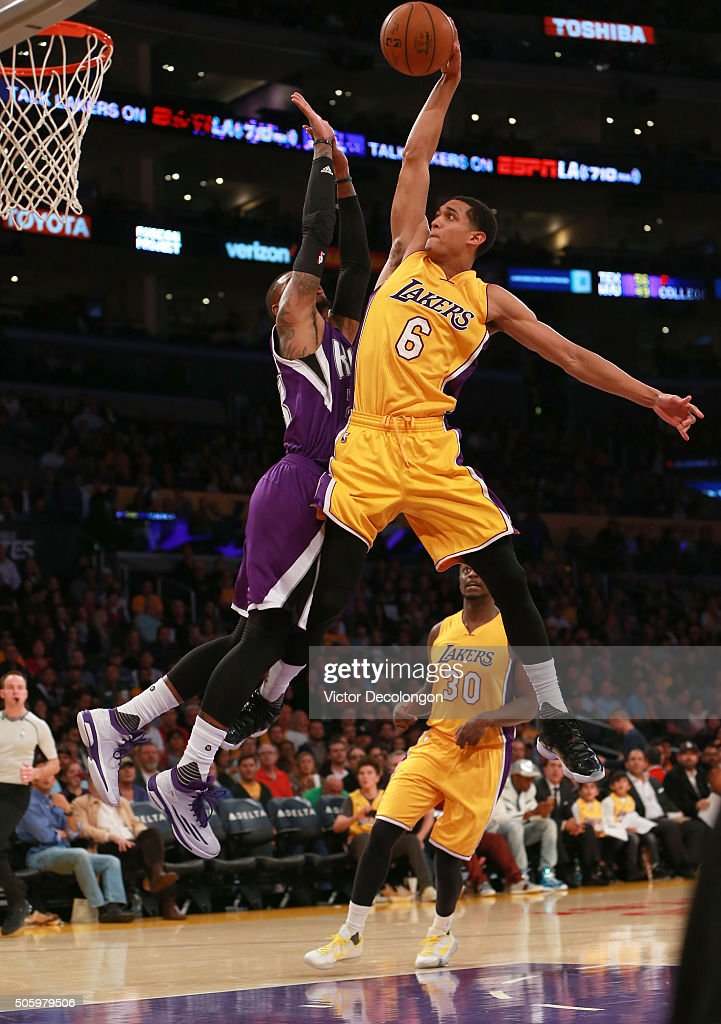 <a gi-track='captionPersonalityLinkClicked' href=/galleries/search?phrase=Jordan+Clarkson&family=editorial&specificpeople=7471825 ng-click='$event.stopPropagation()'>Jordan Clarkson</a> #6 of the Los Angeles Lakers goes up for a slam dunk against <a gi-track='captionPersonalityLinkClicked' href=/galleries/search?phrase=Ben+McLemore&family=editorial&specificpeople=9966388 ng-click='$event.stopPropagation()'>Ben McLemore</a> #23 of the Sacramento Kings in the second half during the NBA game at Staples Center on January 20, 2016 in Los Angeles, California. The Kings defeated the Lakers 112-93.