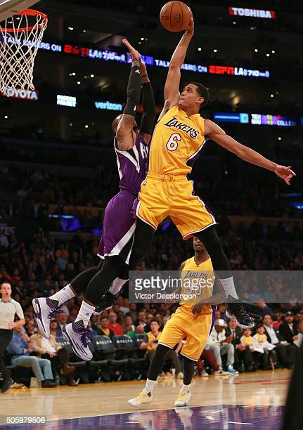 Jordan Clarkson of the Los Angeles Lakers goes up for a slam dunk against Ben McLemore of the Sacramento Kings in the second half during the NBA game...