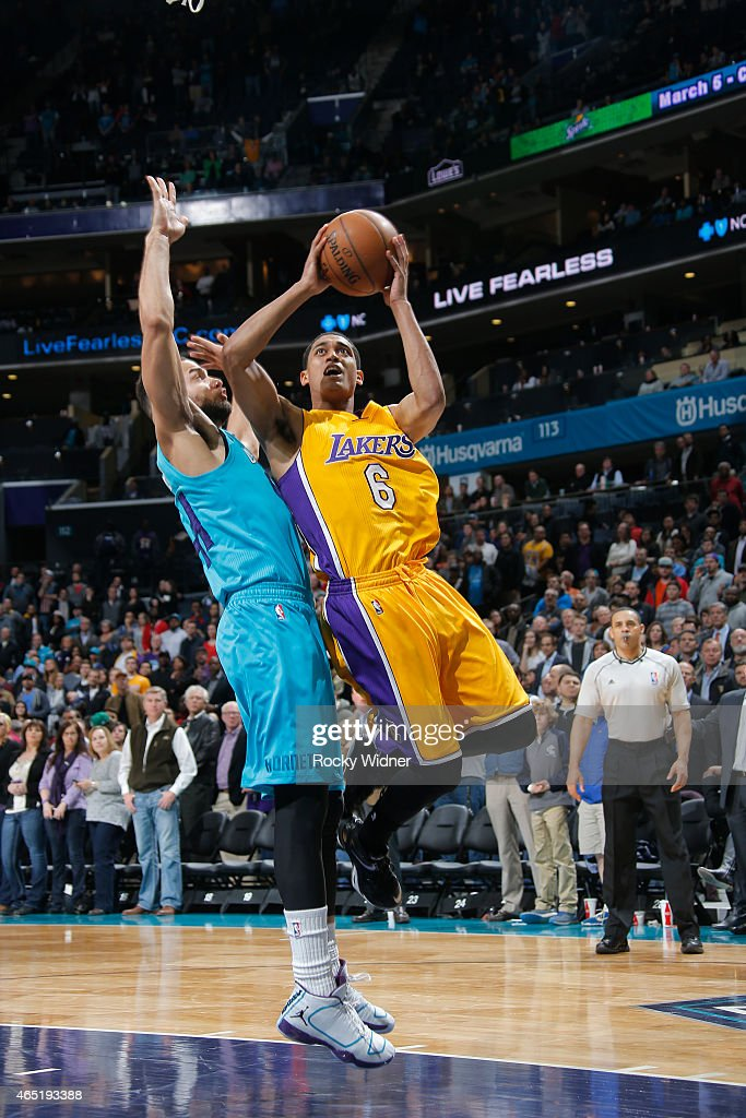Jordan Clarkson of the Los Angeles Lakers goes up for the shot against Jeff Taylor of the Charlotte Hornets on March 3 2015 at at Time Warner Cable...