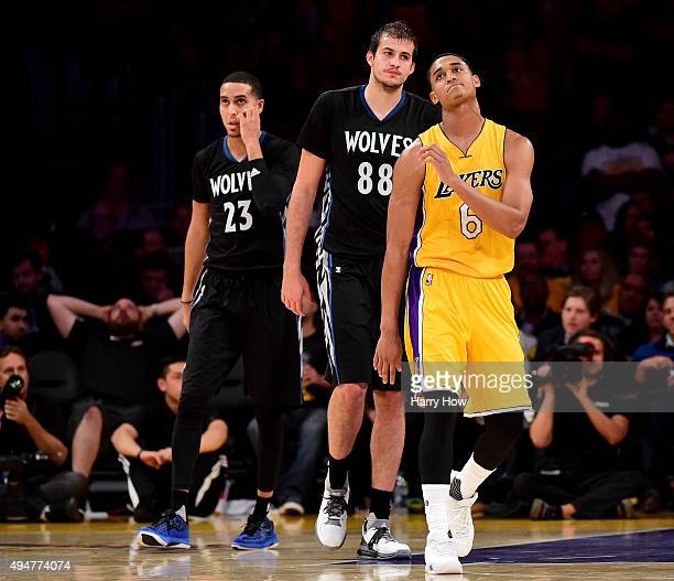 Jordan Clarkson of the Los Angeles Lakers reacts in front of Nemanja Bjelica and Kevin Martin of the Minnesota Timberwolves after a missed free throw...