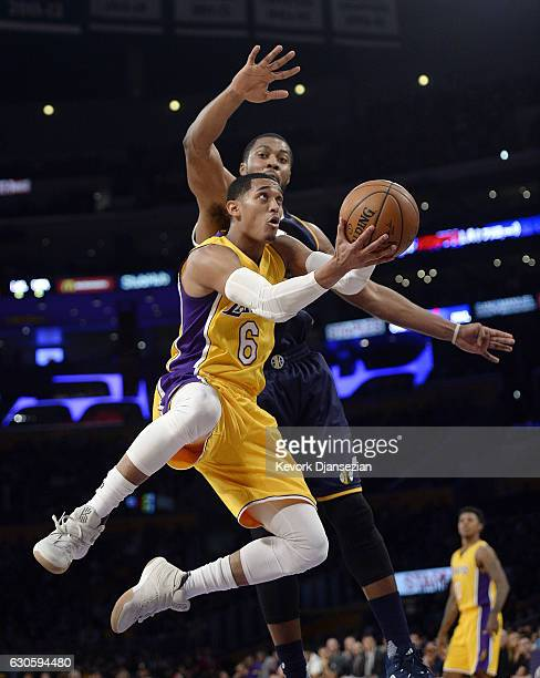 Jordan Clarkson of the Los Angeles Lakers scores against Derrick Favors of the Utah Jazz during the first half half of the basketball game at Staples...