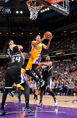 Jordan Clarkson of the Los Angeles Lakers shoots a layup against Jason Thompson of the Sacramento Kings on April 13 2015 at Sleep Train Arena in...