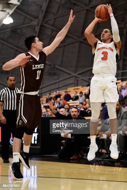 Jordan Cohen of the Lehigh Mountain Hawks defends against Devin Cannady of the Princeton Tigers during the first half at L Stockwell Jadwin Gymnasium...