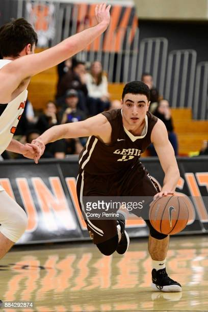 Jordan Cohen of the Lehigh Mountain Hawks drives against Sebastian Much of the Princeton Tigers during the second half at L Stockwell Jadwin...