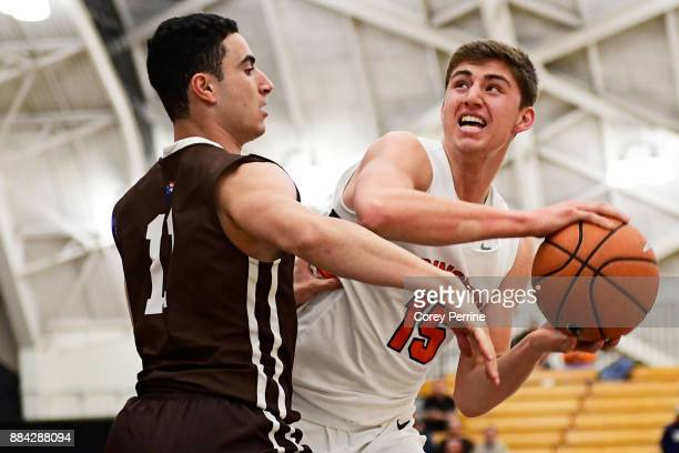 Jordan Cohen of the Lehigh Mountain Hawks pressures Ryan Schwieger of the Princeton Tigers during the first half at L Stockwell Jadwin Gymnasium on...