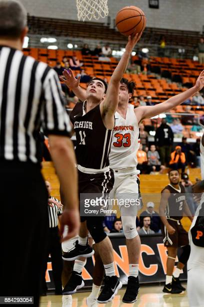 Jordan Cohen of the Lehigh Mountain Hawks scores against Sebastian Much of the Princeton Tigers during the second half at L Stockwell Jadwin...