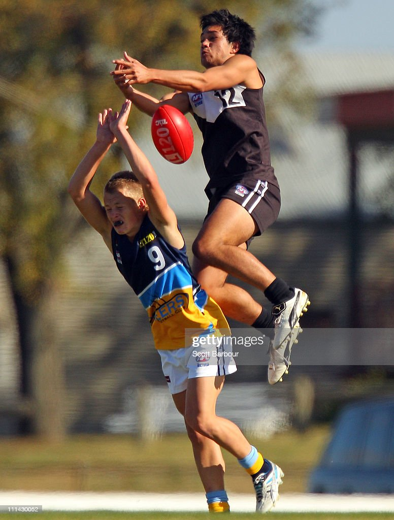Jordan Collins of the Pioneers and Tyrone Ross of the Rebels compete for the ball during the round one TAC Cup match between the North Ballarat Rebels and the Bendigo Pioneers at Eureka Stadium on April 2, 2011 in Melbourne, Australia.