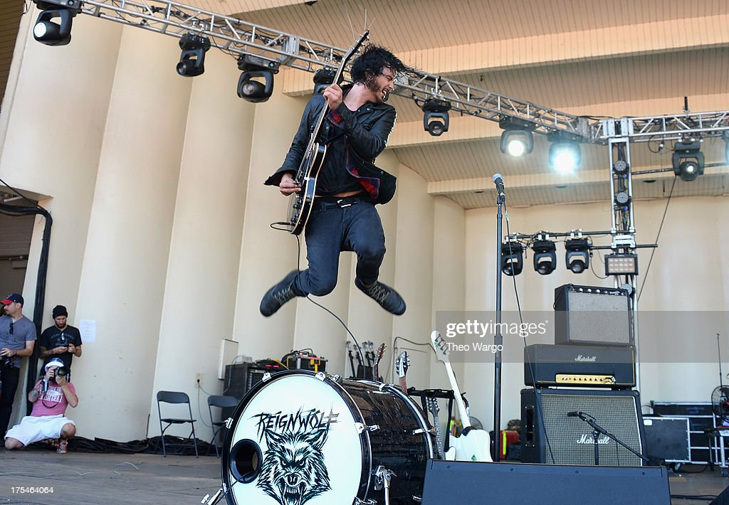 Jordan Cook of Reignwolf performs during Lollapalooza 2013 at Grant Park on August 3, 2013 in Chicago, Illinois.