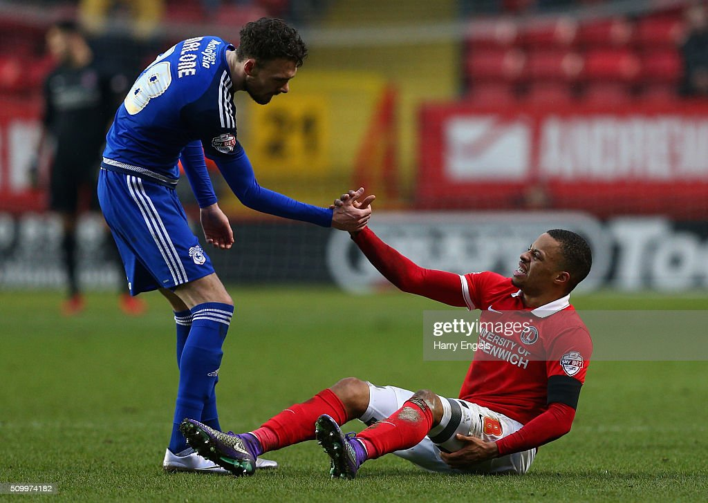 Jordan Cousins of Charlton (R) is helped up by Scott Malone of Cardiff during the Sky Bet Championship match between Charlton Athletic and Cardiff City at The Valley on February 13, 2016 in London, United Kingdom.
