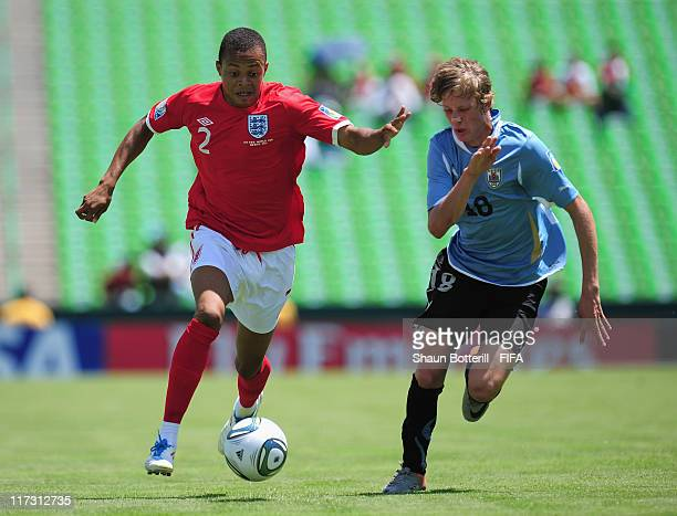 Jordan Cousins of England is challenged by Sebastian Canobra of Uruguay during the FIFA U17 World Cup Group C match between Uruguay and England at...