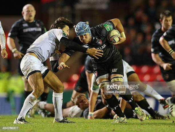 Jordan Crane of Leicester takes on Francois TrinhDuc during the Heineken Cup match between Leicester Tigers and Montpellier at Welford Road on...