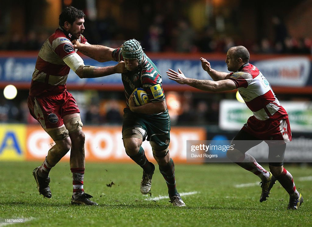 Jordan Crane of Leicester takes on Jim Hamilton (L) and Charlie Sharples during the Aviva Premiership match between Leicester Tigers and Gloucester at Welford Road on December 29, 2012 in Leicester, England.