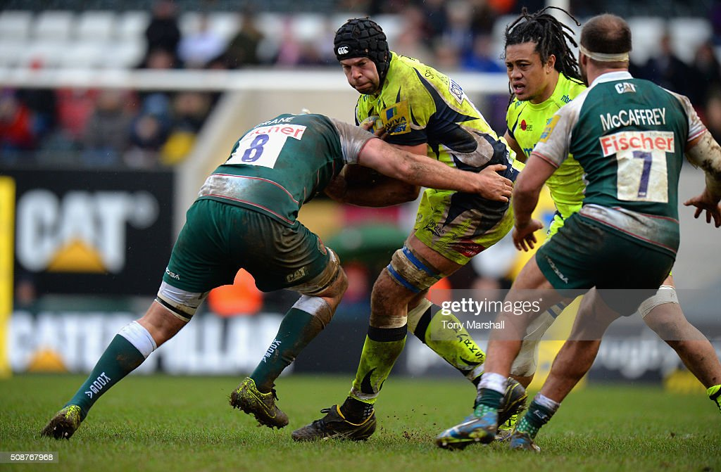 <a gi-track='captionPersonalityLinkClicked' href=/galleries/search?phrase=Jordan+Crane&family=editorial&specificpeople=561906 ng-click='$event.stopPropagation()'>Jordan Crane</a> of Leicester Tigers tackles Josh Beaumont of Sale Sharks during the Aviva Premiership match between Leicester Tigers and Sale Sharks at Welford Road on February 6, 2016 in Leicester, England.