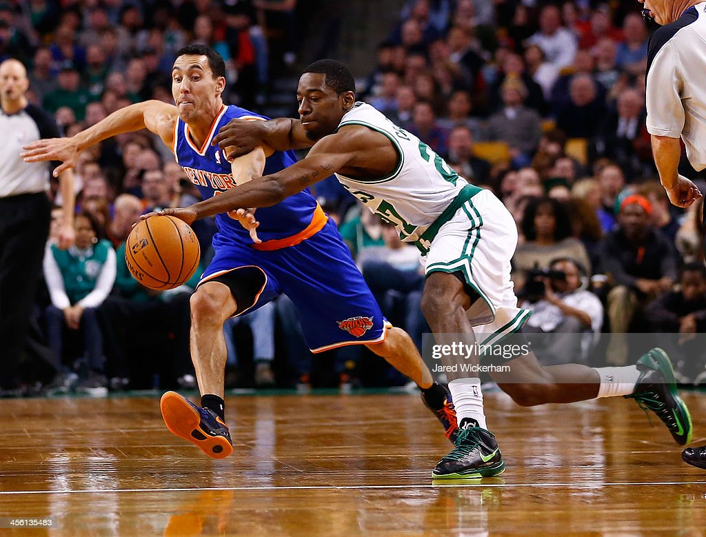 <a gi-track='captionPersonalityLinkClicked' href=/galleries/search?phrase=Jordan+Crawford&family=editorial&specificpeople=4779380 ng-click='$event.stopPropagation()'>Jordan Crawford</a> #27 of the Boston Celtics and <a gi-track='captionPersonalityLinkClicked' href=/galleries/search?phrase=Pablo+Prigioni&family=editorial&specificpeople=664673 ng-click='$event.stopPropagation()'>Pablo Prigioni</a> #9 of the New York Knicks reach for a loose ball in the second half during the game at TD Garden on December 13, 2013 in Boston, Massachusetts.