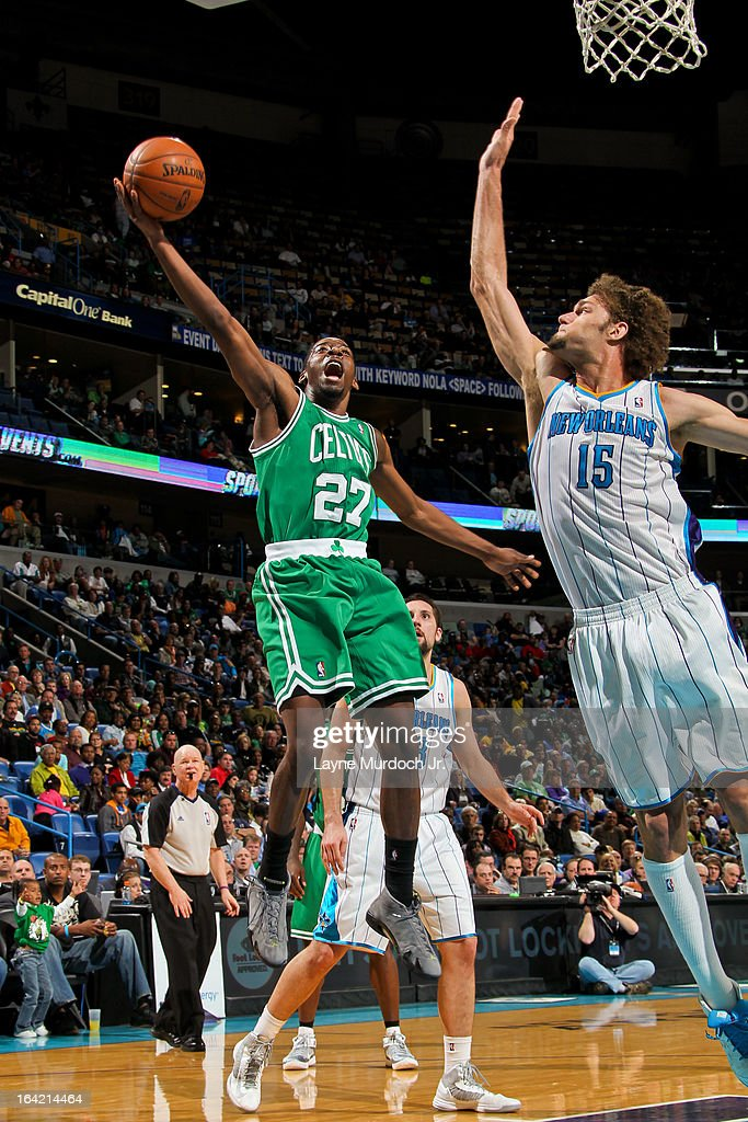 Jordan Crawford #27 of the Boston Celtics attempts a layup against Robin Lopez #15 of the New Orleans Hornets on March 20, 2013 at the New Orleans Arena in New Orleans, Louisiana.