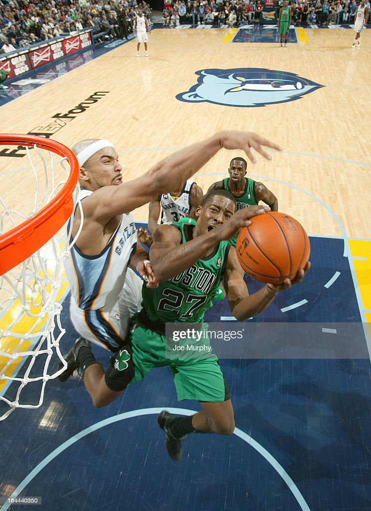Jordan Crawford #27 of the Boston Celtics attempts a shot against Jerryd Bayless #7 of the Memphis Grizzlies on March 23, 2013 at FedExForum in Memphis, Tennessee.