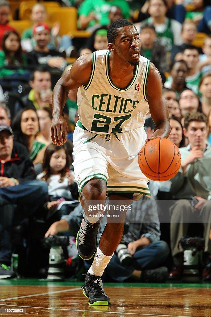 Jordan Crawford #27 of the Boston Celtics brings the ball up court against the Toronto Raptors on October 7, 2013 at the TD Garden in Boston, Massachusetts.