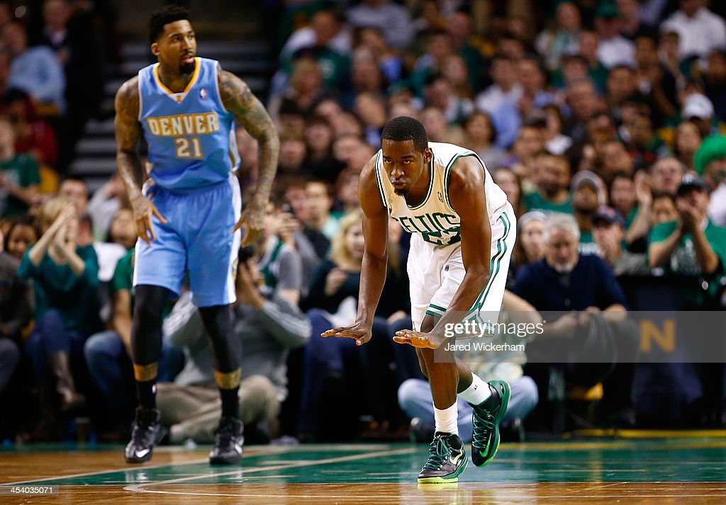 <a gi-track='captionPersonalityLinkClicked' href=/galleries/search?phrase=Jordan+Crawford&family=editorial&specificpeople=4779380 ng-click='$event.stopPropagation()'>Jordan Crawford</a> #27 of the Boston Celtics celebrates following a made basket in the second half against the Denver Nuggets during the game at TD Garden on December 6, 2013 in Boston, Massachusetts.