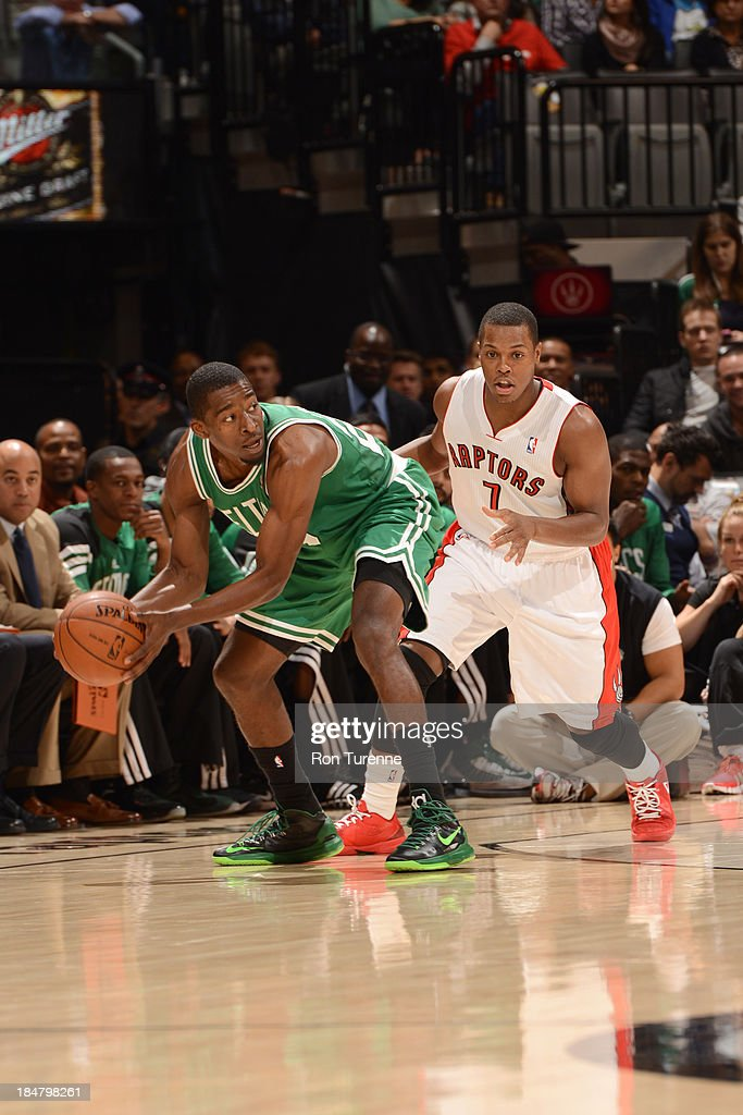 Jordan Crawford #27 of the Boston Celtics controls the ball against Kyle Lowry #7 of the Toronto Raptors during the game on October 16, 2013 at the Air Canada Centre in Toronto, Ontario, Canada.