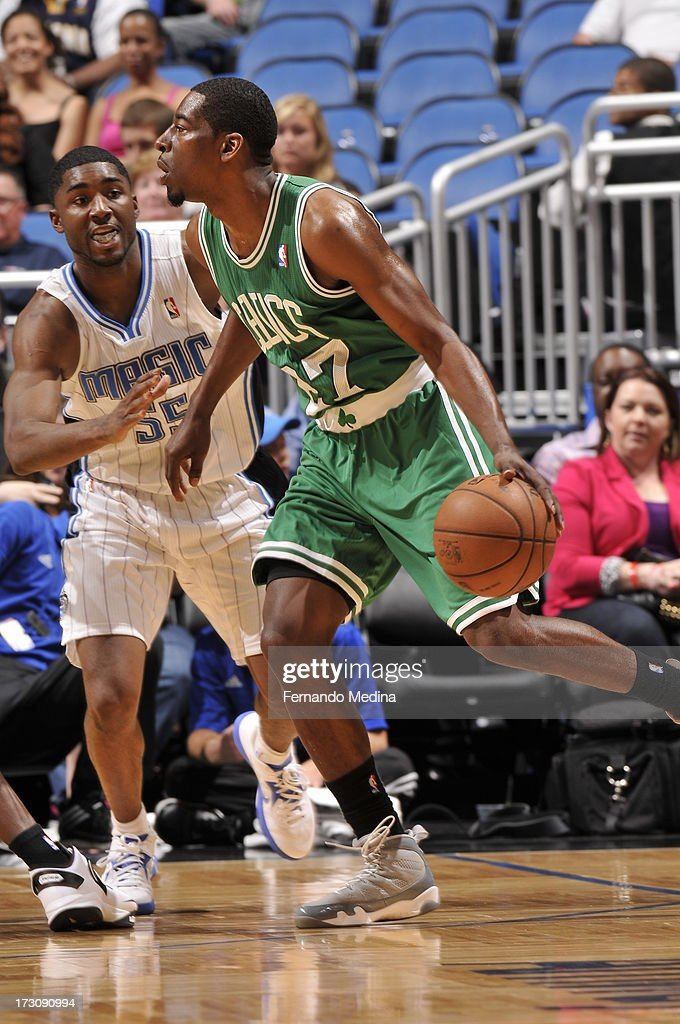 <a gi-track='captionPersonalityLinkClicked' href=/galleries/search?phrase=Jordan+Crawford&family=editorial&specificpeople=4779380 ng-click='$event.stopPropagation()'>Jordan Crawford</a> #27 of the Boston Celtics drives against <a gi-track='captionPersonalityLinkClicked' href=/galleries/search?phrase=E%27Twaun+Moore&family=editorial&specificpeople=4877476 ng-click='$event.stopPropagation()'>E'Twaun Moore</a> #55 of the Orlando Magic on April 13, 2013 at Amway Center in Orlando, Florida.