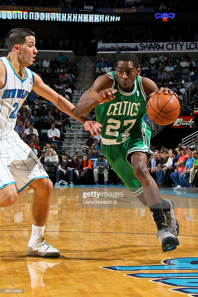 Jordan Crawford #27 of the Boston Celtics drives against Greivis Vasquez #21 of the New Orleans Hornets on March 20, 2013 at the New Orleans Arena in New Orleans, Louisiana.