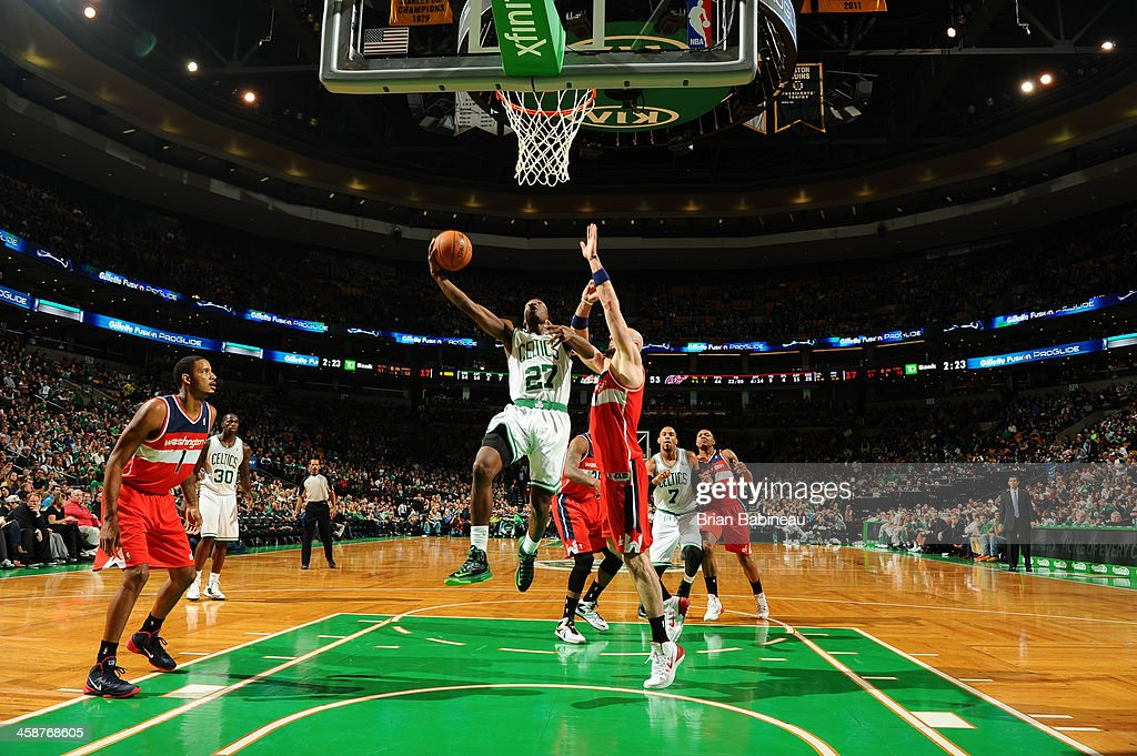 Jordan Crawford #27 of the Boston Celtics drives to the basket against the Washington Wizards on December 21, 2013 at the TD Garden in Boston, Massachusetts.