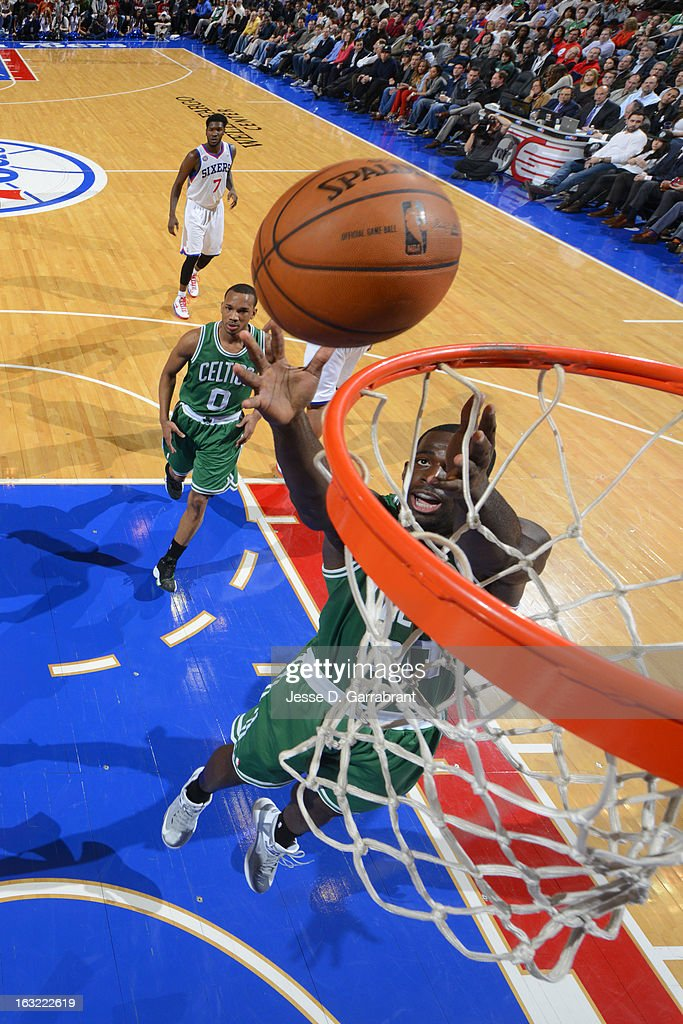 Jordan Crawford #27 of the Boston Celtics grabs a rebound against the Philadelphia 76ers on March 5, 2013 at the Wells Fargo Center in Philadelphia, Pennsylvania.