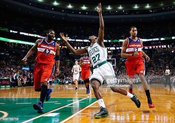 Jordan Crawford of the Boston Celtics reacts after losing control of the ball at the end of the first quarter against the Washington Wizardsduring...