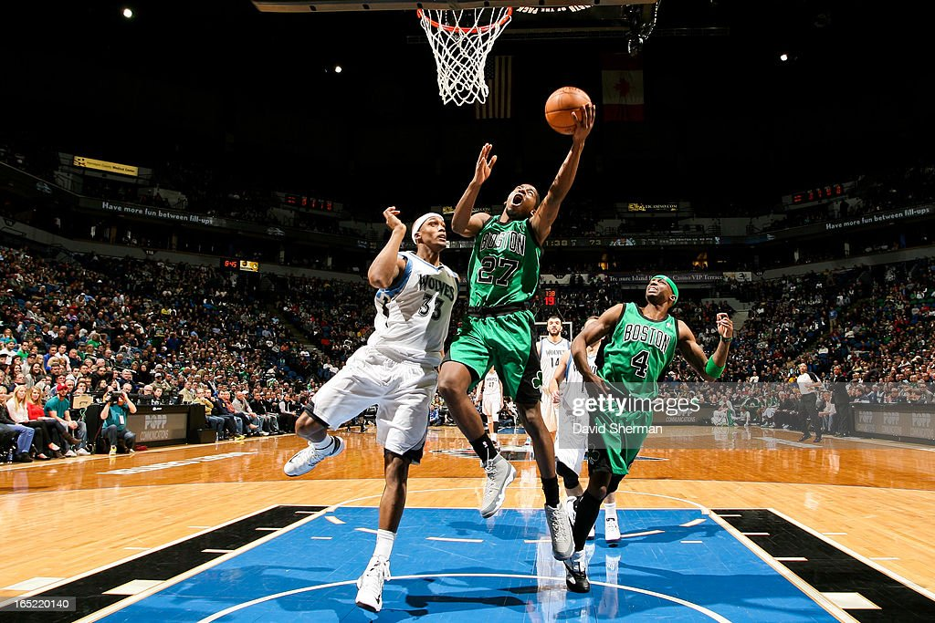<a gi-track='captionPersonalityLinkClicked' href=/galleries/search?phrase=Jordan+Crawford&family=editorial&specificpeople=4779380 ng-click='$event.stopPropagation()'>Jordan Crawford</a> #27 of the Boston Celtics shoots a layup against <a gi-track='captionPersonalityLinkClicked' href=/galleries/search?phrase=Dante+Cunningham&family=editorial&specificpeople=683729 ng-click='$event.stopPropagation()'>Dante Cunningham</a> #33 of the Minnesota Timberwolves on April 1, 2013 at Target Center in Minneapolis, Minnesota.