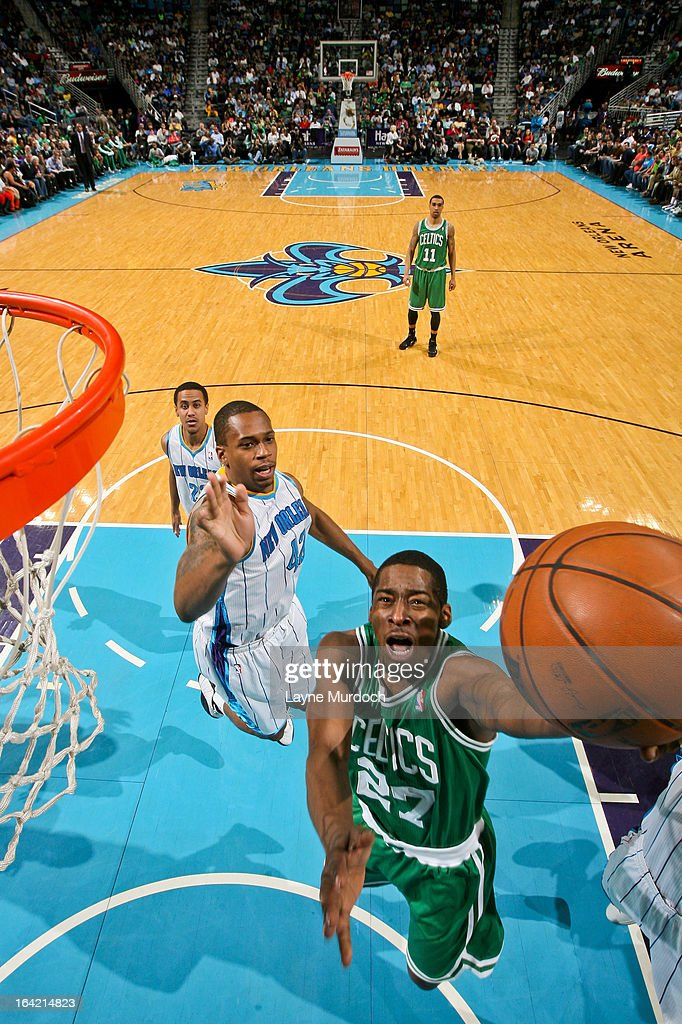 Jordan Crawford #27 of the Boston Celtics shoots a layup against Lance Thomas #42 of the New Orleans Hornets on March 20, 2013 at the New Orleans Arena in New Orleans, Louisiana.