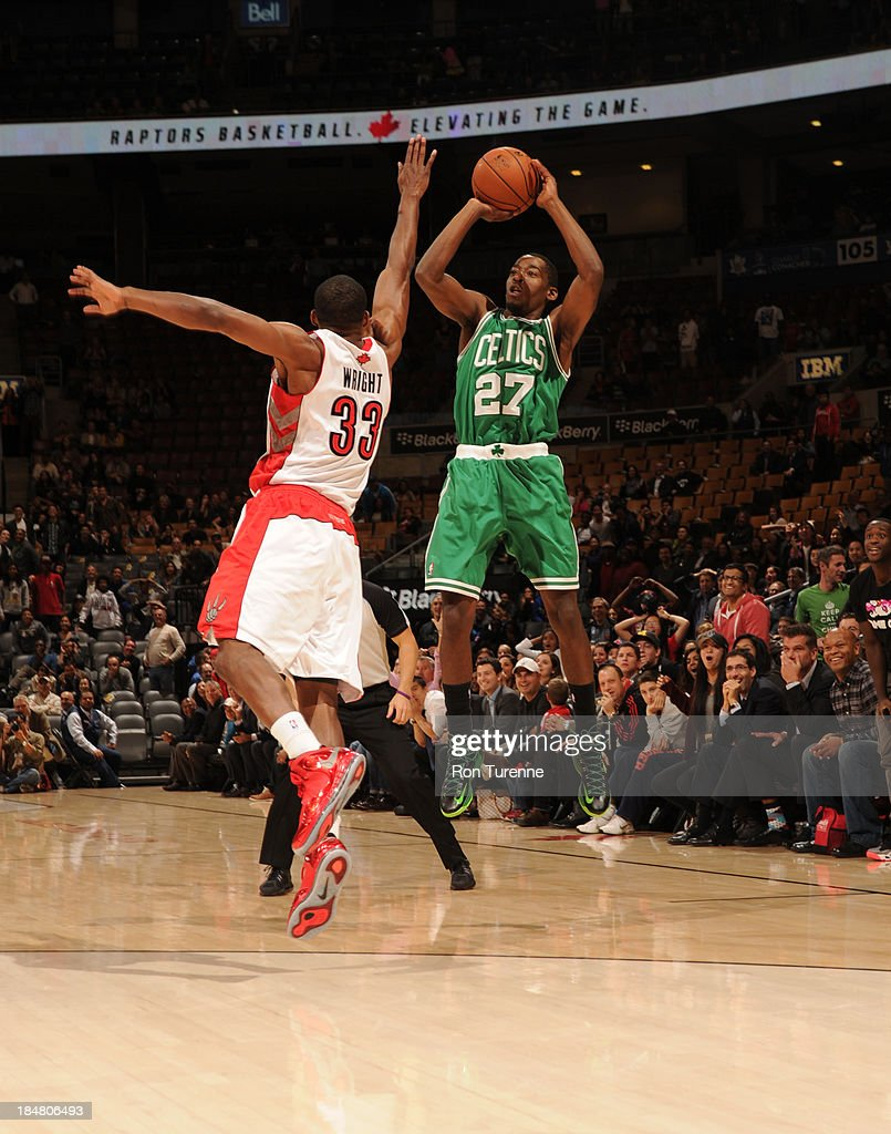 <a gi-track='captionPersonalityLinkClicked' href=/galleries/search?phrase=Jordan+Crawford&family=editorial&specificpeople=4779380 ng-click='$event.stopPropagation()'>Jordan Crawford</a> #27 of the Boston Celtics shoots against Chris Wright #33 of the Toronto Raptors during the game on October 16, 2013 at the Air Canada Centre in Toronto, Ontario, Canada.