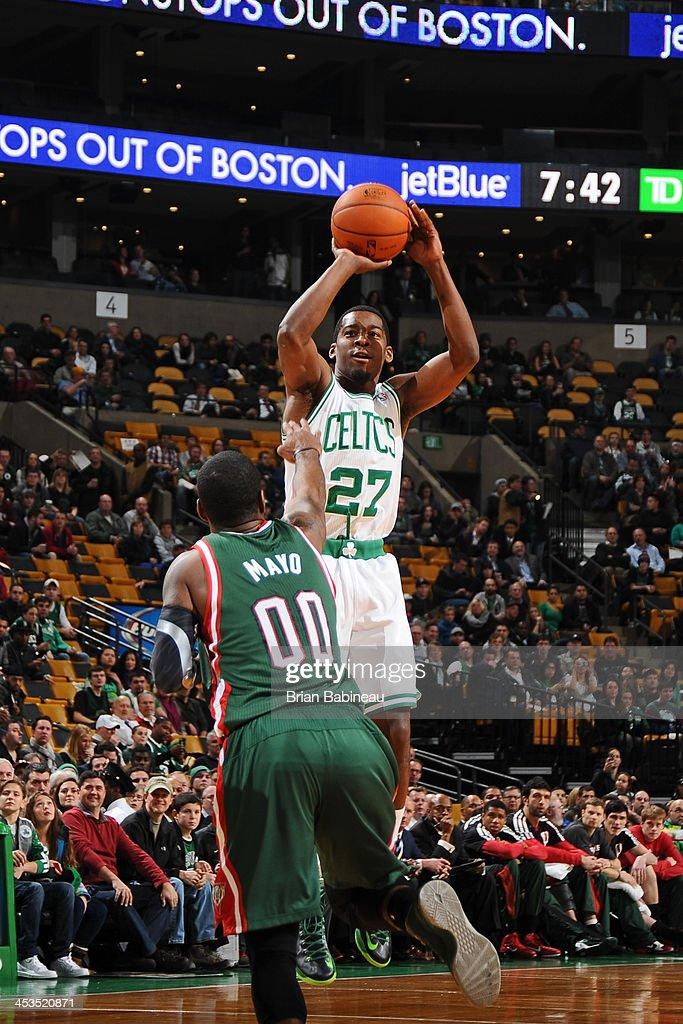 Jordan Crawford #27 of the Boston Celtics shoots against the Milwaukee Bucks on December 3, 2013 at the TD Garden in Boston, Massachusetts.