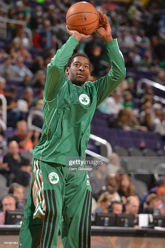 Jordan Crawford #27 of the Boston Celtics warms up during halftime against the Phoenix Suns on February 22, 2013 at U.S. Airways Center in Phoenix, Arizona.