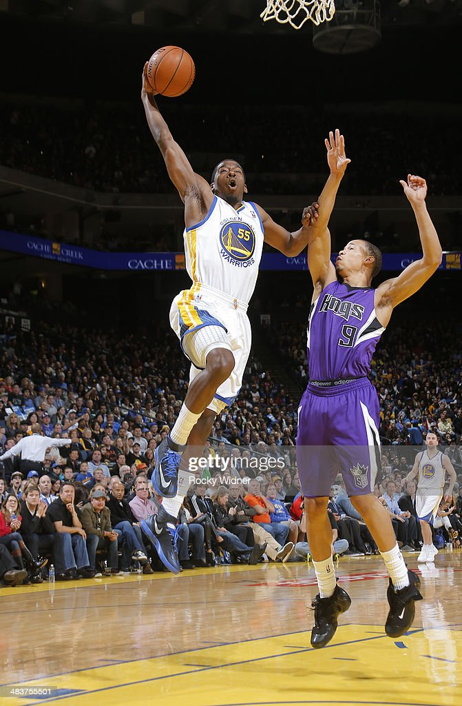 Jordan Crawford #55 of the Golden State Warriors dunks against Jared Cunningham #9 of the Sacramento Kings on April 4, 2014 at Oracle Arena in Oakland, California.