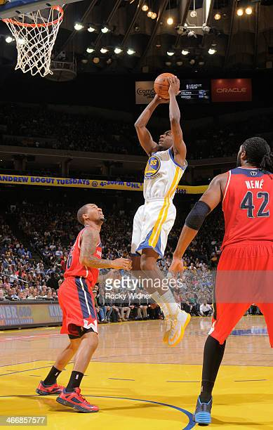 Jordan Crawford of the Golden State Warriors rebounds against Eric Maynor of the Washington Wizards on January 28 2014 at Oracle Arena in Oakland...