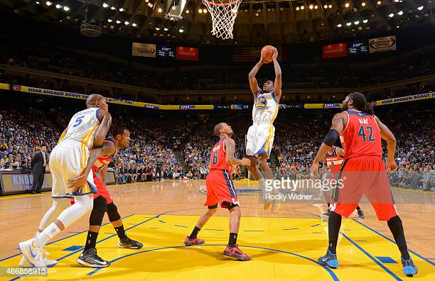 Jordan Crawford of the Golden State Warriors rebounds against Eric Maynor and Nene of the Washington Wizards on January 28 2014 at Oracle Arena in...