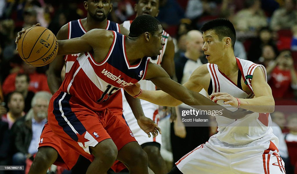 Jordan Crawford #15 of the Washington Wizards and Jeremy Lin #7 of the Houston Rockets battle for the ball at the Toyota Center on December 12, 2012 in Houston, Texas.