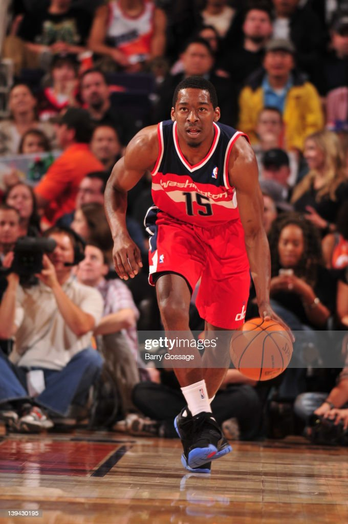 <a gi-track='captionPersonalityLinkClicked' href=/galleries/search?phrase=Jordan+Crawford&family=editorial&specificpeople=4779380 ng-click='$event.stopPropagation()'>Jordan Crawford</a> #15 of the Washington Wizards brings the ball upcourt against the Phoenix Suns in an NBA game played on February 20, 2012 at U.S. Airways Center in Phoenix, Arizona.