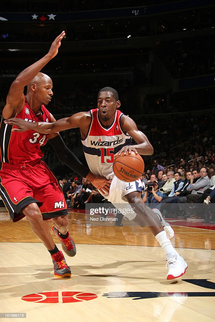 Jordan Crawford #15 of the Washington Wizards drives against Ray Allen #34 of the Miami Heat during the game at the Verizon Center on December 4, 2012 in Washington, DC.