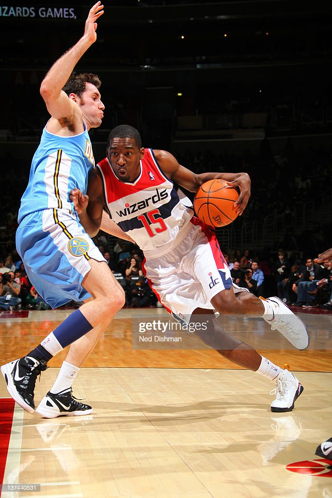 <a gi-track='captionPersonalityLinkClicked' href=/galleries/search?phrase=Jordan+Crawford&family=editorial&specificpeople=4779380 ng-click='$event.stopPropagation()'>Jordan Crawford</a> #15 of the Washington Wizards drives against Rudy Fernandez #5 of the Denver Nuggets during the game at the Verizon Center on January 20, 2012 in Washington, DC.