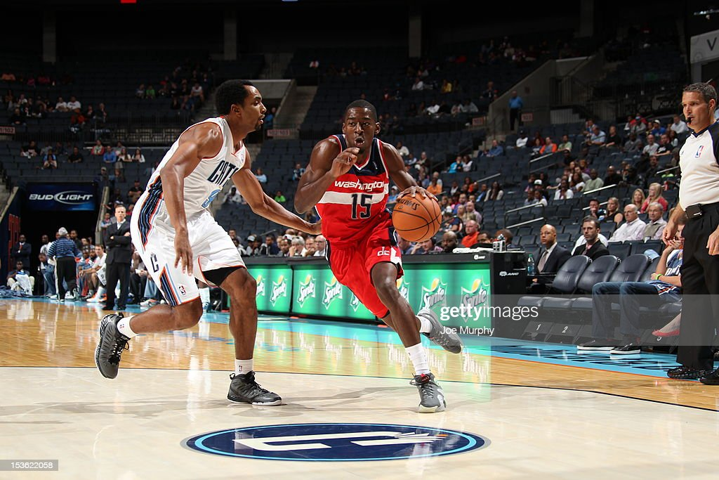 Jordan Crawford #15 of the Washington Wizards drives the ball against Gerald Henderson #9 of the Charlotte Bobcats during the game between the Charlotte Bobcats and the Washington Wizards at the Time Warner Cable Arena on October 7, 2012 in Charlotte, North Carolina.