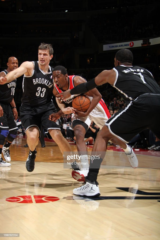 Jordan Crawford #15 of the Washington Wizards drives to the basket against Mirza Teletovic #33 of the Brooklyn Nets on January 4, 2013 at the Verizon Center in Washington, DC.