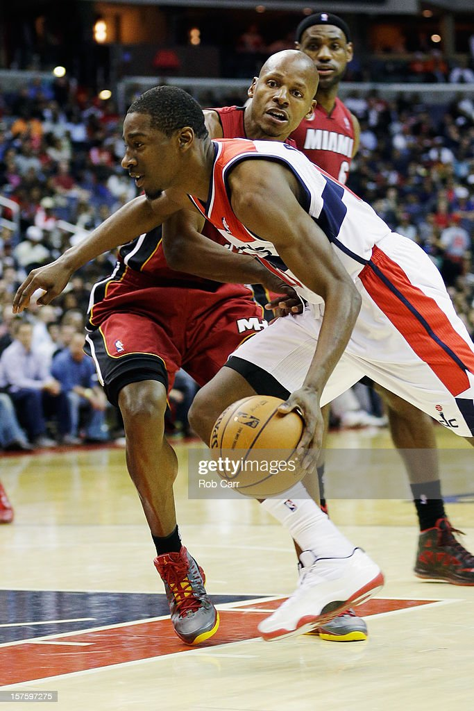 Jordan Crawford #15 of the Washington Wizards drives to the basket against Ray Allen #34 of the Miami Heat during the second half at Verizon Center on December 4, 2012 in Washington, DC.