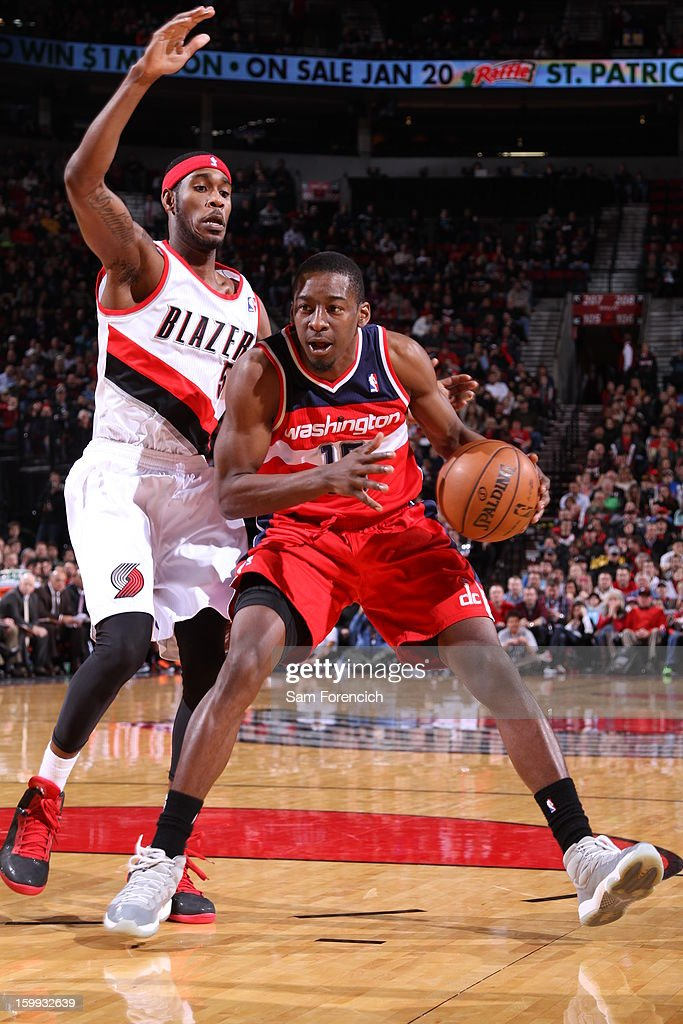 <a gi-track='captionPersonalityLinkClicked' href=/galleries/search?phrase=Jordan+Crawford&family=editorial&specificpeople=4779380 ng-click='$event.stopPropagation()'>Jordan Crawford</a> #15 of the Washington Wizards drives to the basket against the Portland Trail Blazers on January 21, 2013 at the Rose Garden Arena in Portland, Oregon.