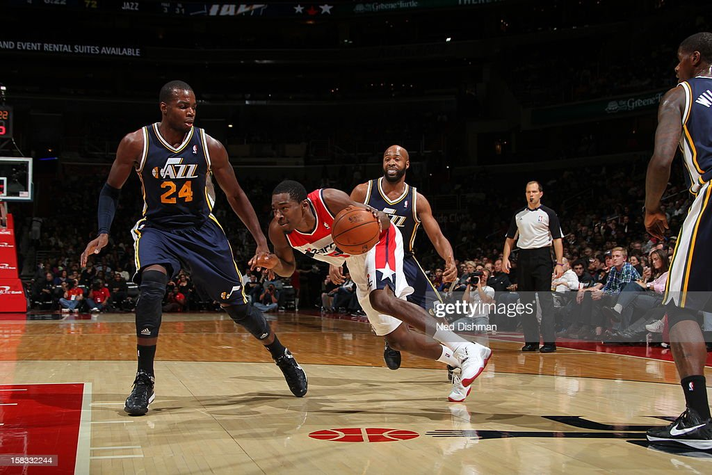 <a gi-track='captionPersonalityLinkClicked' href=/galleries/search?phrase=Jordan+Crawford&family=editorial&specificpeople=4779380 ng-click='$event.stopPropagation()'>Jordan Crawford</a> #15 of the Washington Wizards drives to the basket while guarded by <a gi-track='captionPersonalityLinkClicked' href=/galleries/search?phrase=Paul+Millsap&family=editorial&specificpeople=880017 ng-click='$event.stopPropagation()'>Paul Millsap</a> #24 of the Utah Jazz at the Verizon Center on November 17, 2012 in Washington, DC.